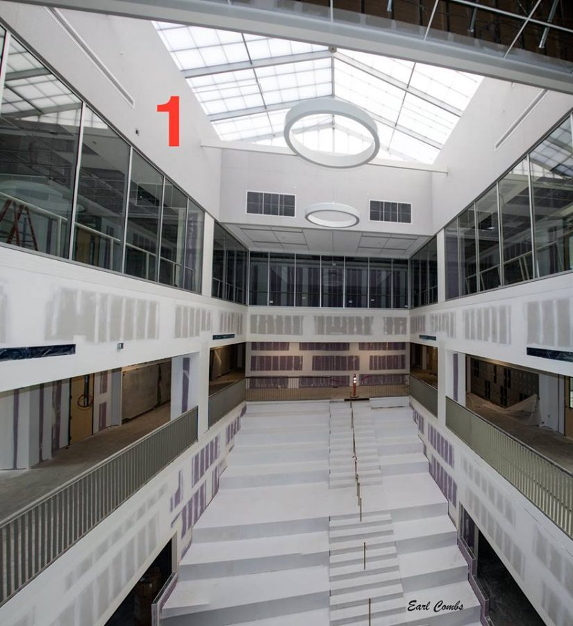 Atrium in the three-story classroom building. Lathrop Construction has applied a metal surface over the concrete. Eventually it will get a beautiful terrazzo tile covering. Photo by Earl Combs.