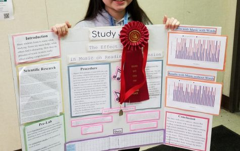 Pinole Valley High School senior Anna Chang with her award-winning Science Fair project.