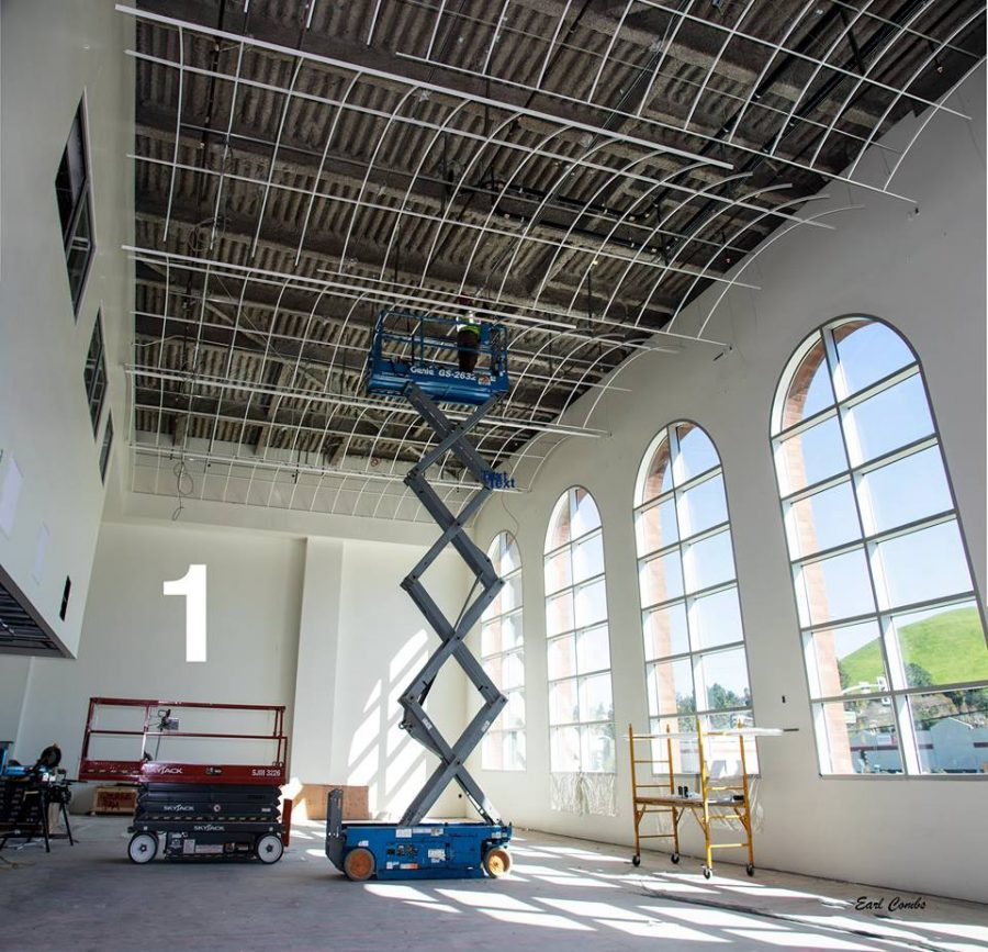 Arched+ceilings+being+installed+in+the+library.