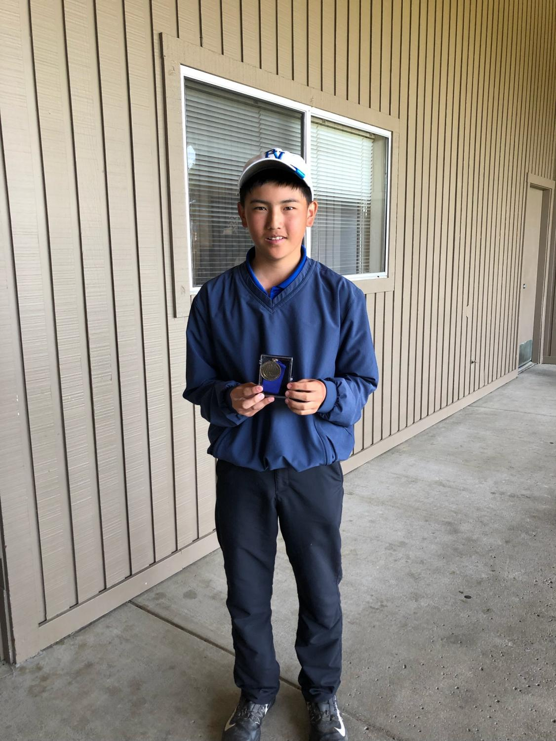 Tyler Momono with his TCAL Championship Medal. Next stop: NCS.