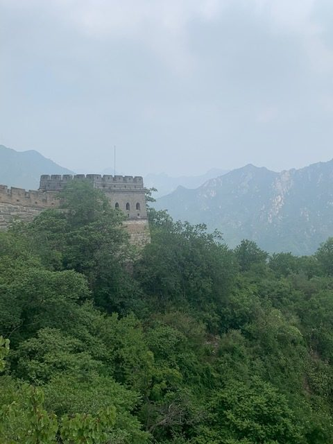 A restored section of the great wall and the surrounding mountains.