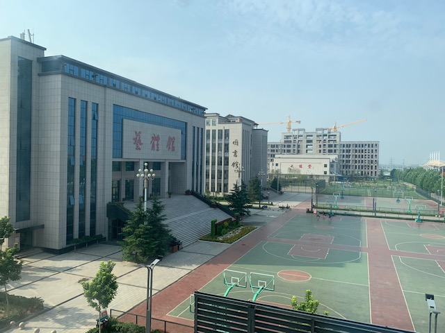 The school and basketball courts in the daytime