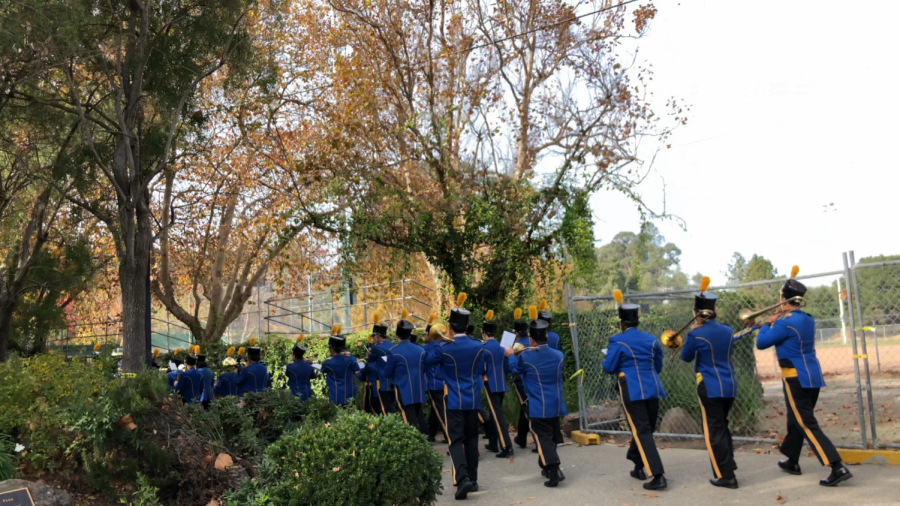 The Pinole Valley High School Marching Band marching out of Fernandez Park after the event had concluded.