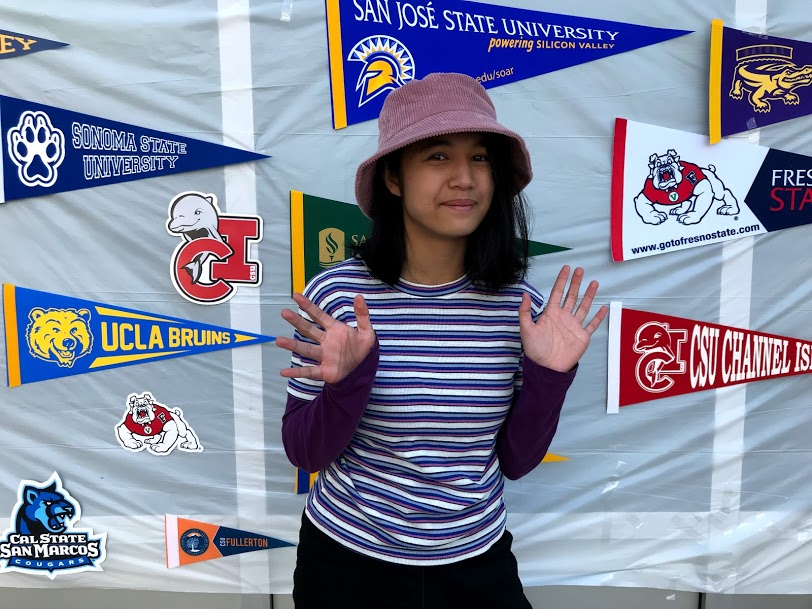 Spartan Ink reporter Sara Molina posing at Tuesday's College Week photo booth.