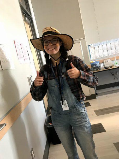 Kaitlynn Dwy ('21) as a cheerful scarecrow.