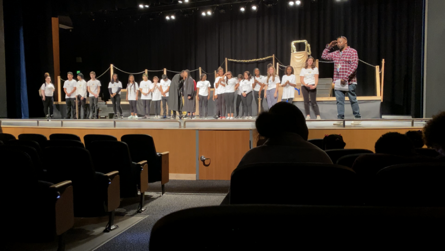 Mr. Anderson alongside the cast and crew members of the Romeo and Juliet play.