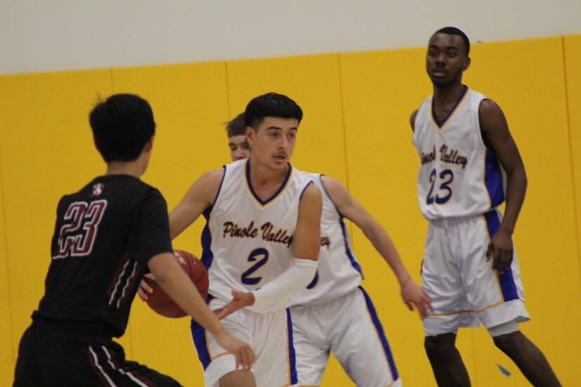 Mateo Tahsini in recent basketball action. Mateo is a two-sport star at PVHS.