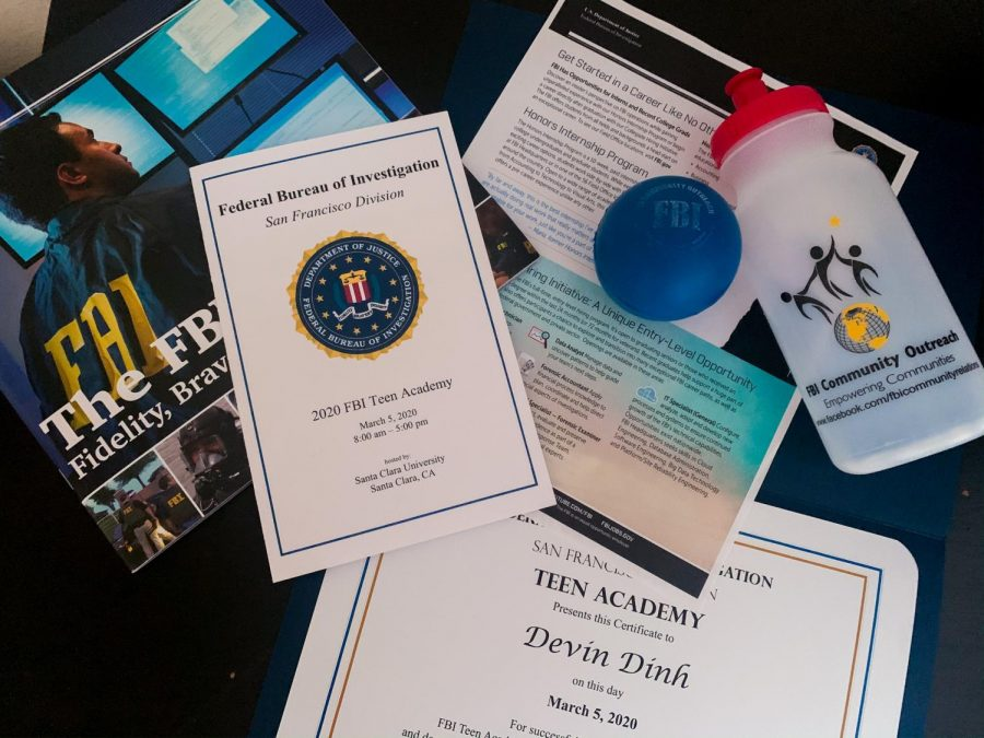 Items, information, and a certificate that I received from attending the FBI Teen Academy. There was a white hazmat suit passed out, but it is not pictured.