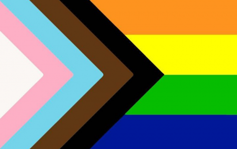 The progress Pride flag, which combines elements of the original Pride flag with the transgender Pride flag and the brown and black stripes representing Queer people of color and is intended to bring awareness to these often erased communities.