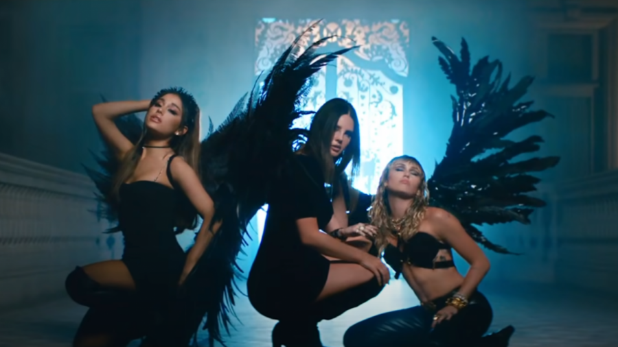 """(From left to right): Grande, Del Rey, and Cyrus in the music video for """"Don't Call Me Angel (Charlie's Angels)""""."""