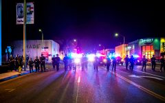 May 30, 2020, Los Angeles, CA, USA: LAPD advance westbound on Melrose Ave Saturday evening as some shops were looted. ..Los Angeles Police Department officers clash with protestors and looters in the Melrose and Fairfax shopping area west of downtown Los Angeles Saturday evening May 30th, 2020 in Los Angeles, CA USA. Demonstrations began peacefully earlier in the day as marchers demanded justice for the murder of George Floyd and an end to police brutality. In the evening dozens of stores were broken into and their contents looted as arrests were made, as police officers fired tear gas and less than lethal munitions. (Credit Image: © Stuart Palley/ZUMA Wire)