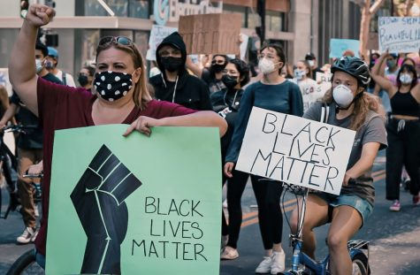 "Justice for George Floyd protest occurring with protestors holding signs saying ""Black Lives Matter"" in Downtown San Jose on Friday, May 29, 2020."