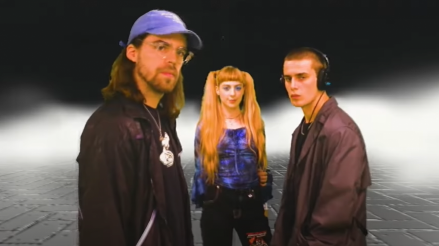 "The members of Planet 1999; (from left to right); Charles Teiller, Caroline Maulin, and Alexandre Teiller in the music video for ""Party""."